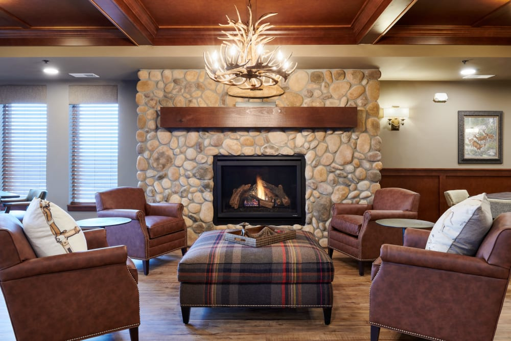 Chairs and fireplace at Willows Landing in Monticello, Minnesota