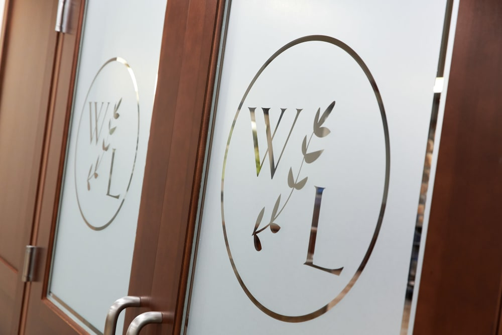 Company logo on doors at Willows Landing in Monticello, Minnesota