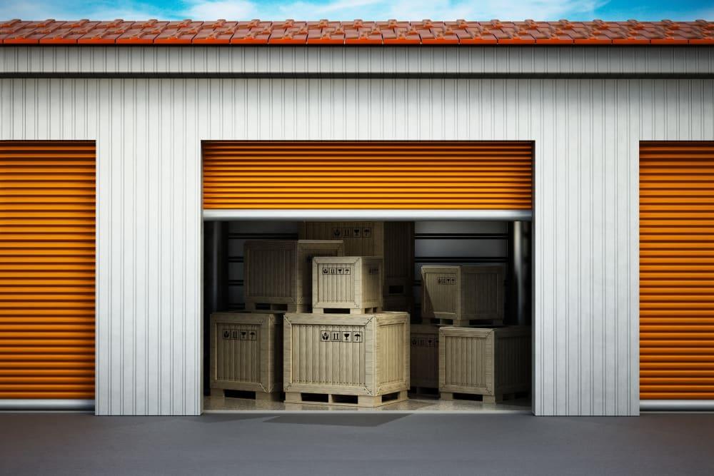 Open storage unit full of boxes at Monster Self Storage in Winston-Salem, North Carolina