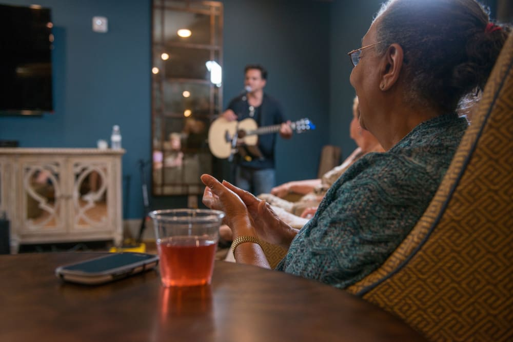 Resident enjoying music at Watermere at the Preserve in North Richland Hills, Texas