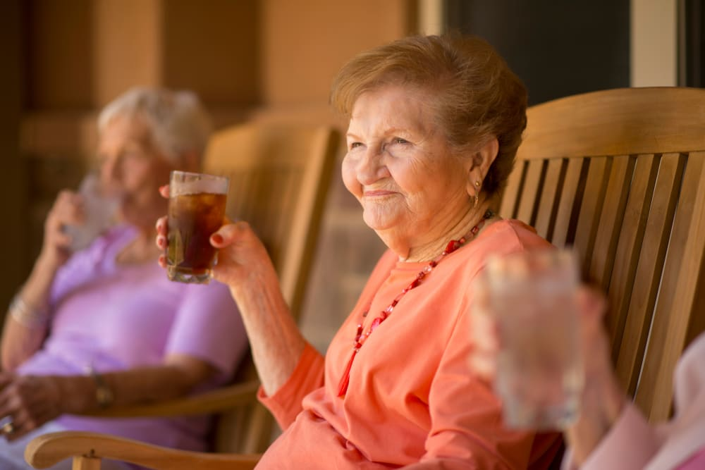 Residents enjoying tea and sunshine outside at Watermere at Flower Mound in Flower Mound, Texas
