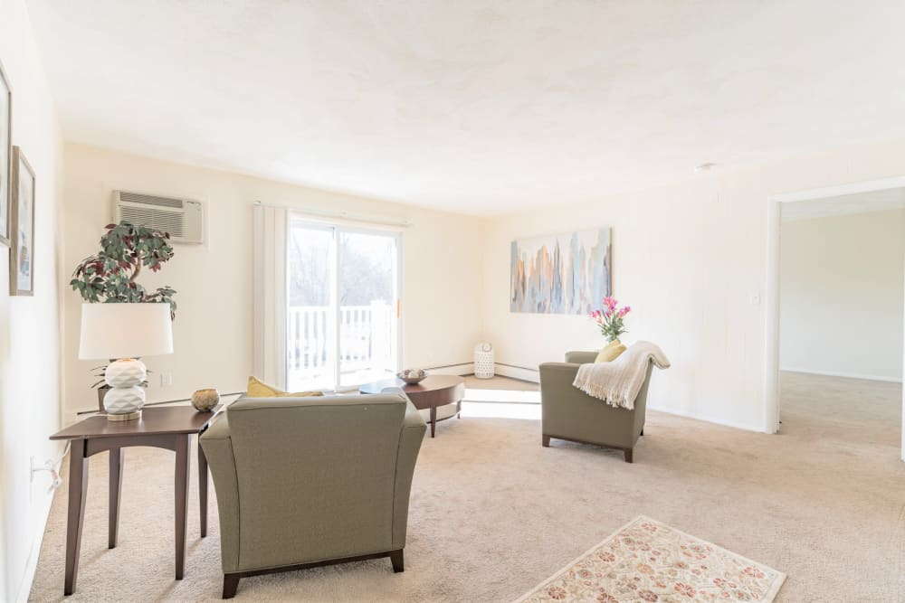 Well lit living room in apartment at { Park Village West in Westborough, Massachusetts