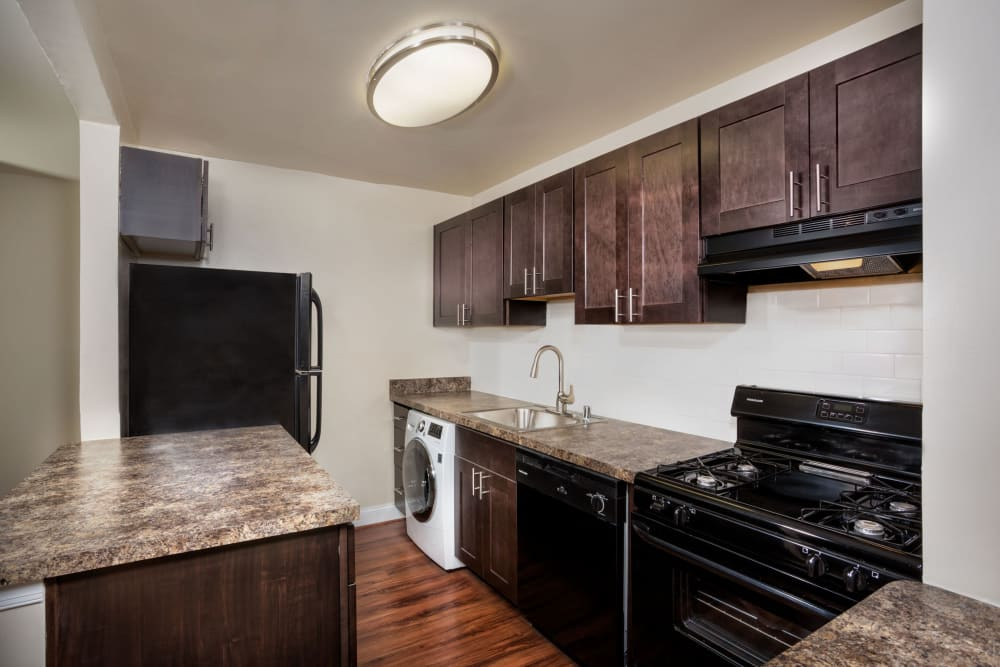 Kitchen cabinetry at Admiral Place Apartments in Suitland, Maryland