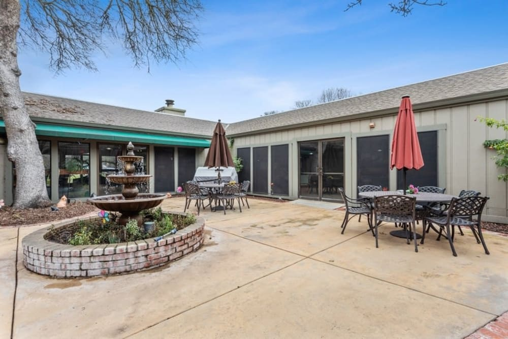 Back patio with seating at The Crest at Citrus Heights in Citrus Heights, California