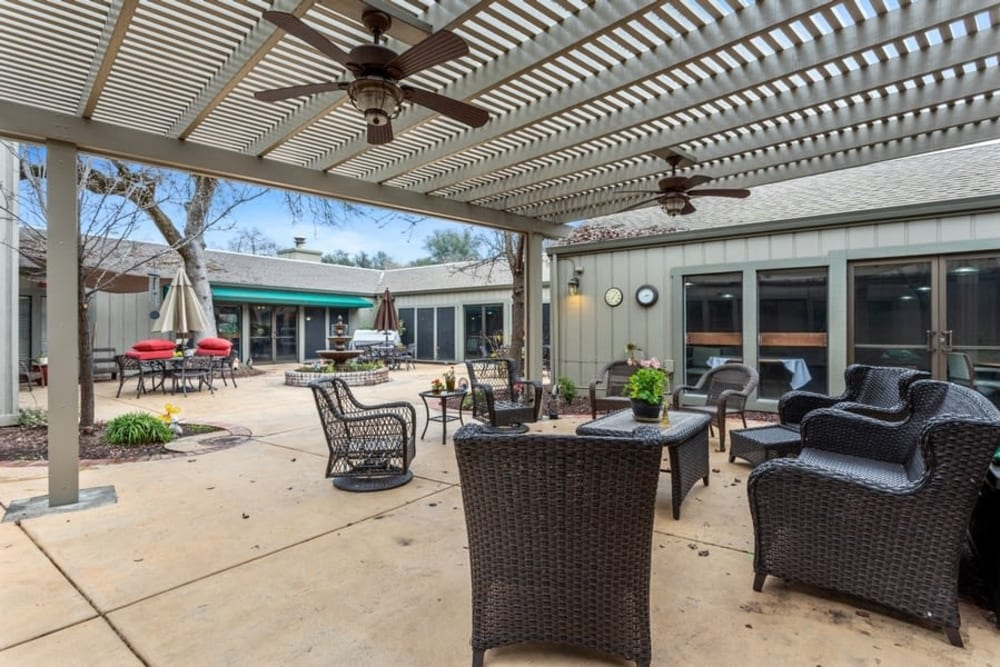 Covered patio with furniture at The Crest at Citrus Heights in Citrus Heights, California