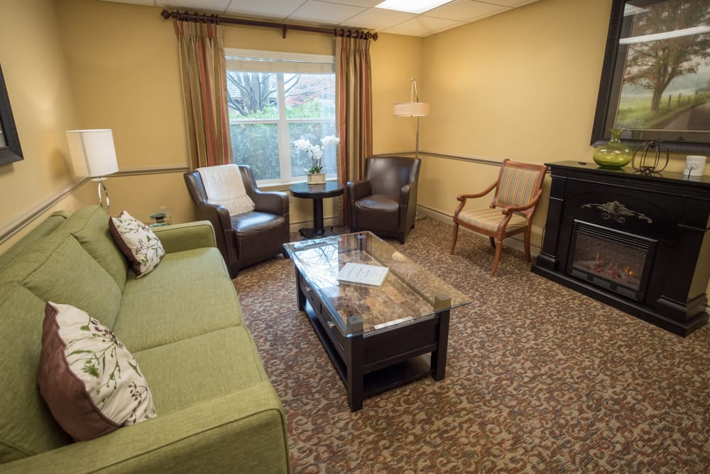 Living space with couches and fireplace at Kenmore Senior Living in Kenmore, Washington