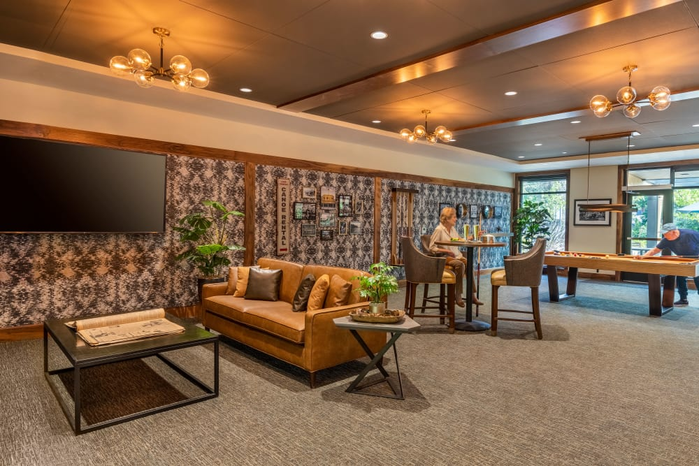 Lounge area with seating, a pool table, tv's and a bar at The Springs at Lake Oswego in Lake Oswego, Oregon