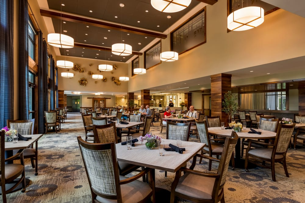 Dining hall with a 3-story ceiling at The Springs at Lake Oswego in Lake Oswego, Oregon