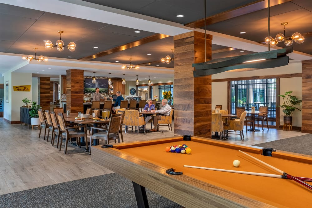 Activity room with space for gatherings and games at The Springs at Lake Oswego in Lake Oswego, Oregon