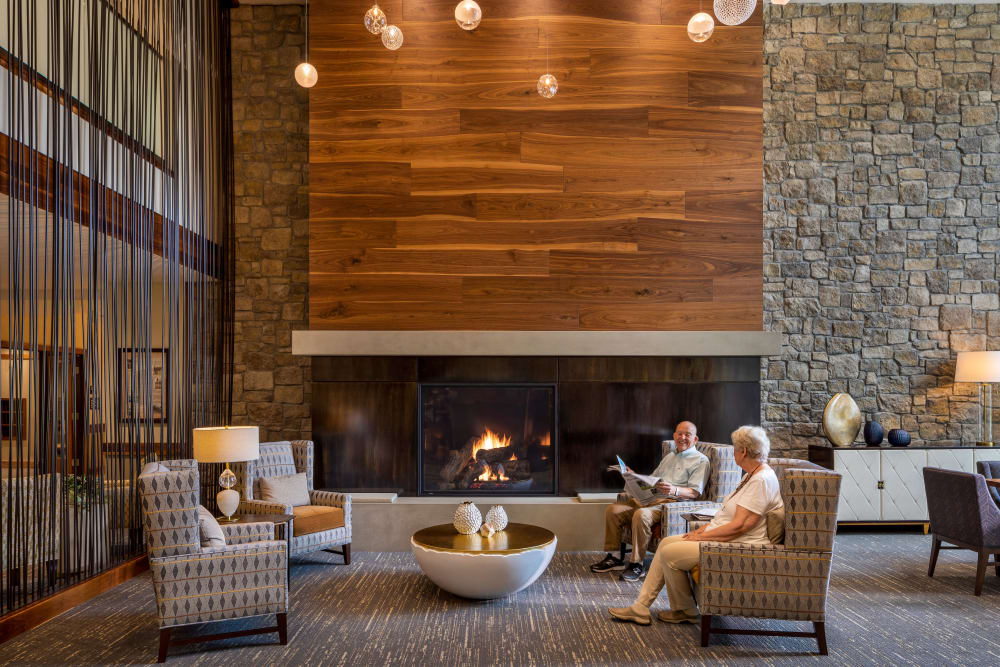 Upscale reception area with plenty of seating and a fireplace at The Springs at Lake Oswego in Lake Oswego, Oregon
