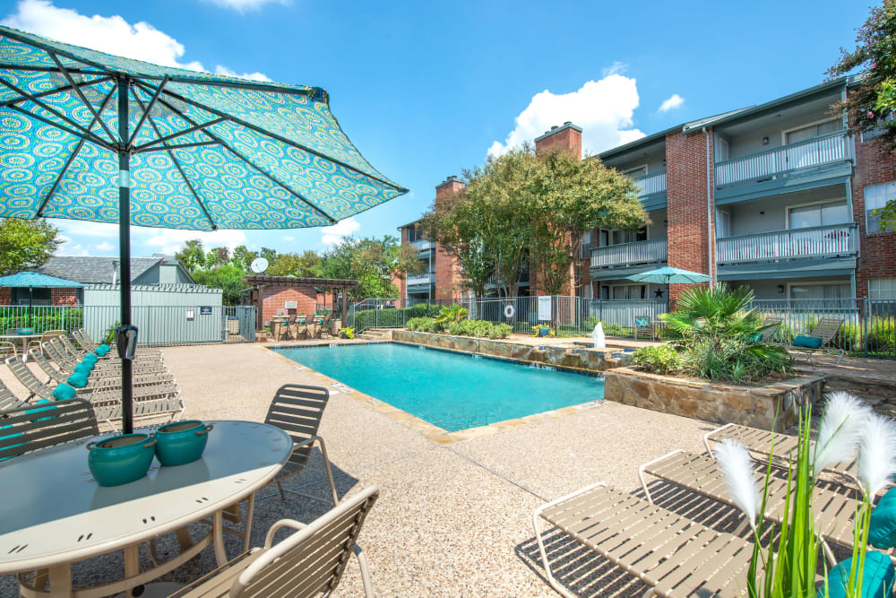 Poolside seating at Lane at Towne Crossing in Mesquite, Texas