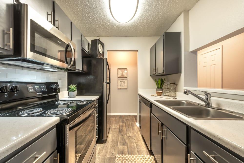 Sleek, modern kitchen at Lane at Towne Crossing in Mesquite, Texas
