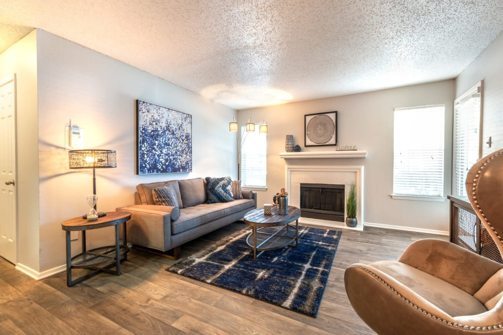 Living room with fireplace at Lane at Towne Crossing in Mesquite, Texas