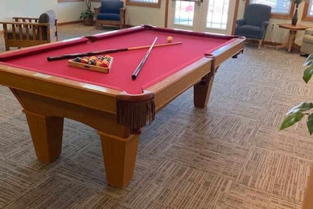 Resident game room with pool table at Prairie Hills Tipton in Tipton, Iowa.