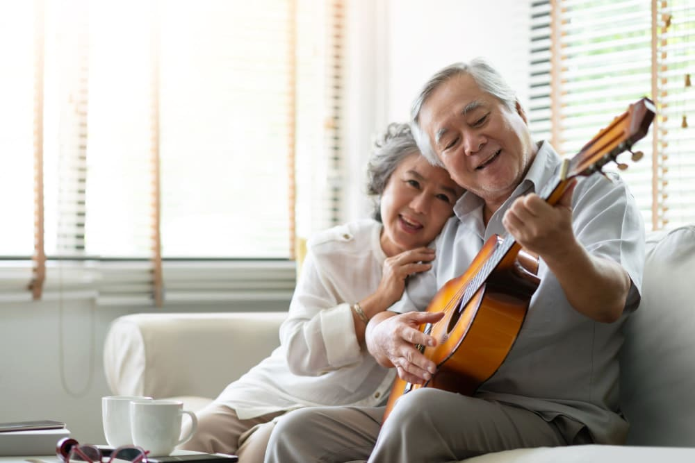 Resident playing guitar for his wife at Leisure Manor Senior Living in Sacramento, California
