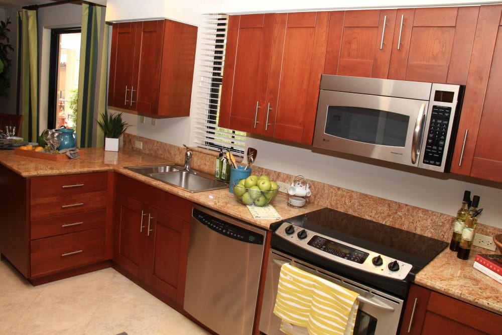 Kitchen with stainless steel appliances at The Heritage at Boca Raton in Boca Raton, Florida