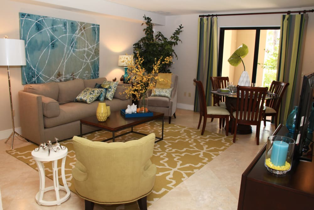 Living room with private patio access at The Heritage at Boca Raton in Boca Raton, Florida