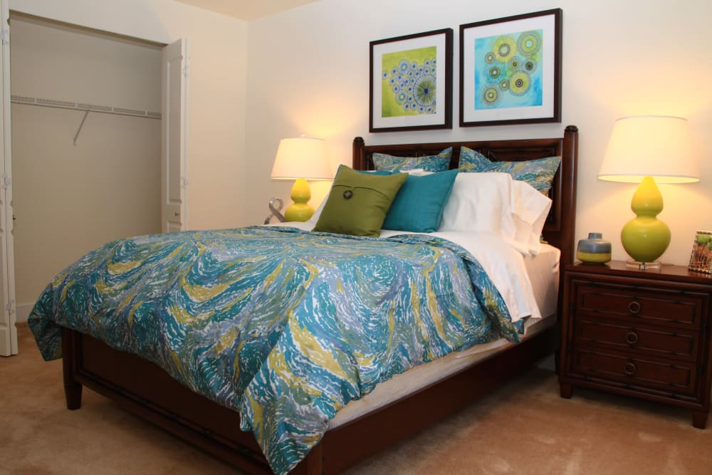 Bedroom with a large walk-in closet at The Heritage at Boca Raton in Boca Raton, Florida