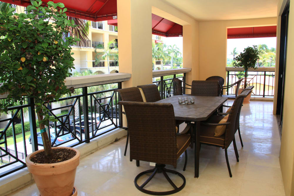 Outdoor, poolside patio at The Heritage at Boca Raton in Boca Raton, Florida