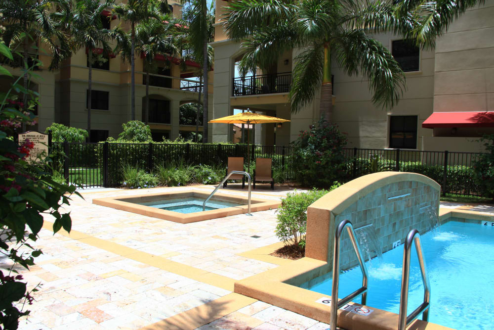 Outdoor pool and hot tub at The Heritage at Boca Raton in Boca Raton, Florida