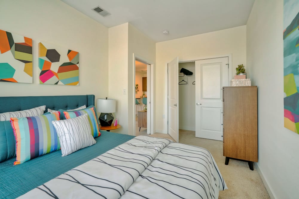 Bedroom with walk-in closet at Indigo 19 in Virginia Beach, Virginia