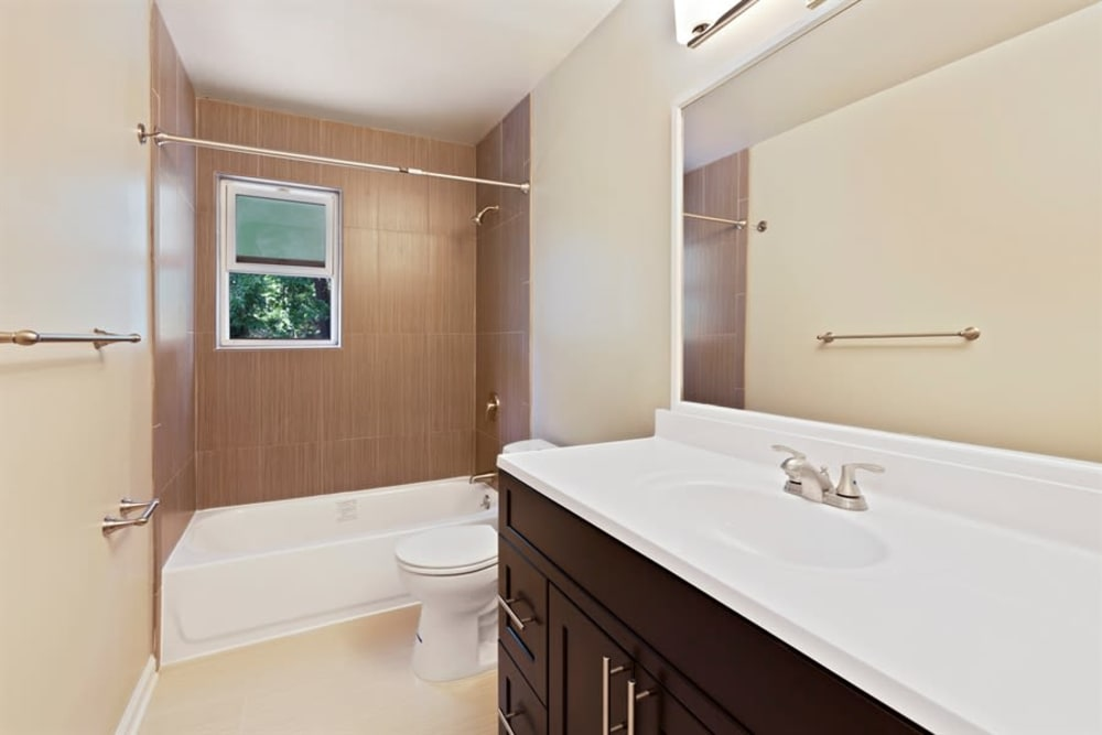 Spacious bathroom with window for some natural light while showing in the morning at Eagle Rock Apartments at North Plainfield in North Plainfield, New Jersey