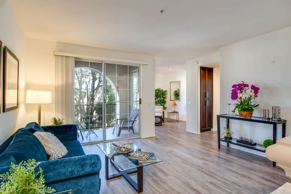 Beautiful hardwood flooring and modern furnishings in a model luxury home's living space at L'Estancia in Studio City, California