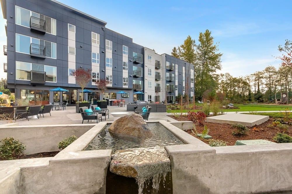 Seating area outdoors at Trillium Apartments in Edmonds, Washington