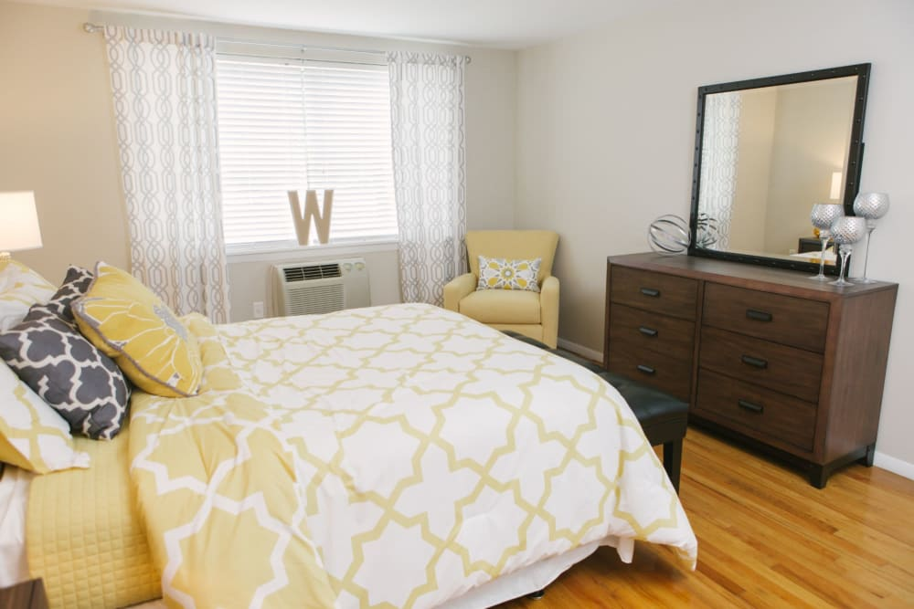 Decorated bedroom with wood flooring at Eagle Rock Apartments at West Hartford in West Hartford, Connecticut