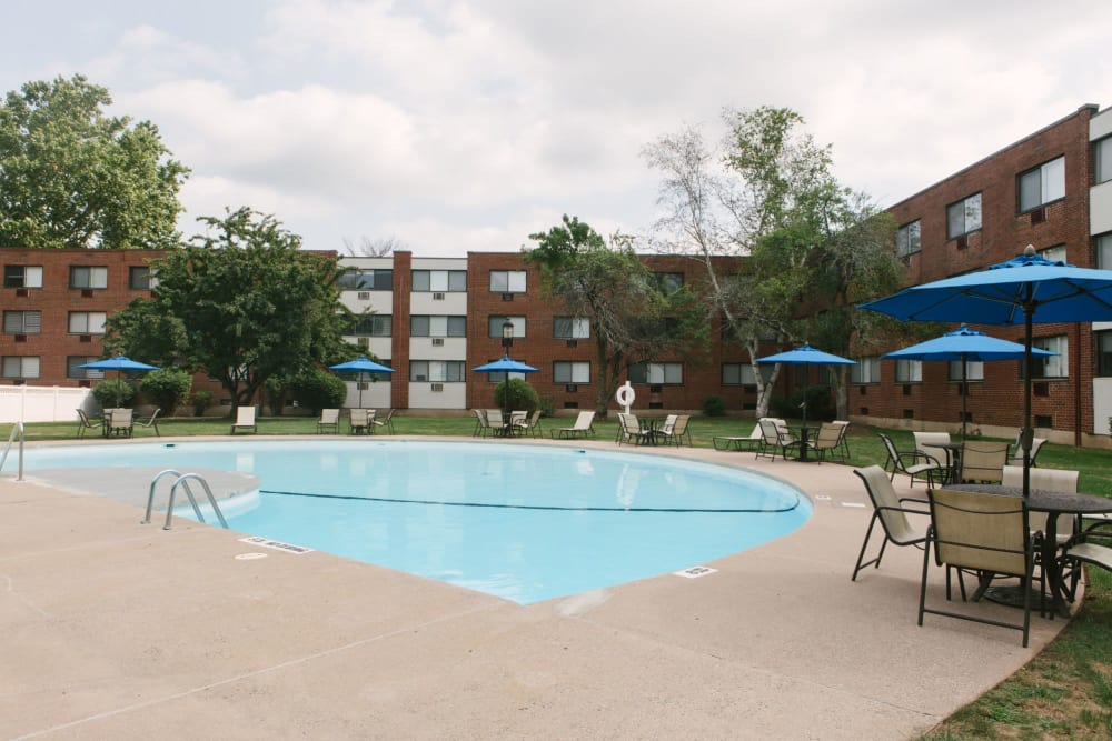 Swimming pool with lots of seating and areas around to hang out on a hot summer day at Eagle Rock Apartments at West Hartford in West Hartford, Connecticut