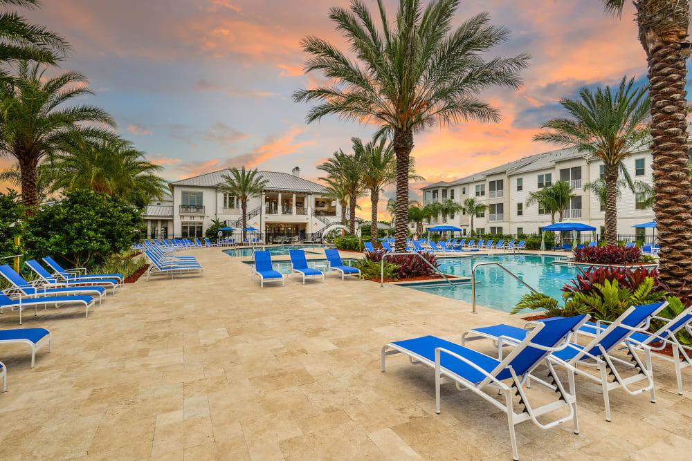 seating around pool at Palm Bay Club at Jacksonville
