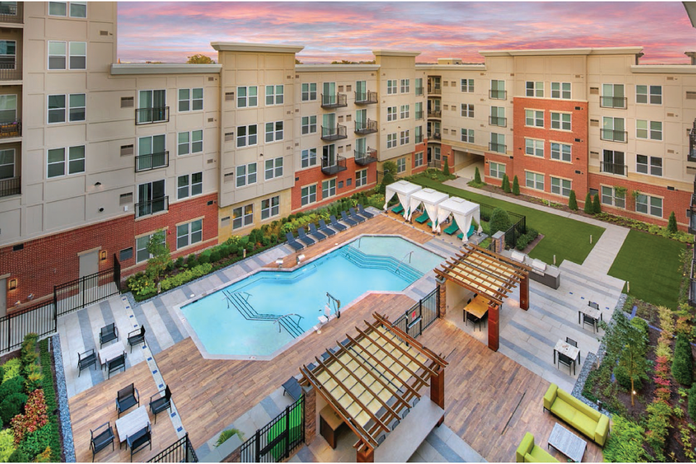 Overview of the exterior resort style swimming pool area at Summerfield at Morgan Metro in Landover, Maryland