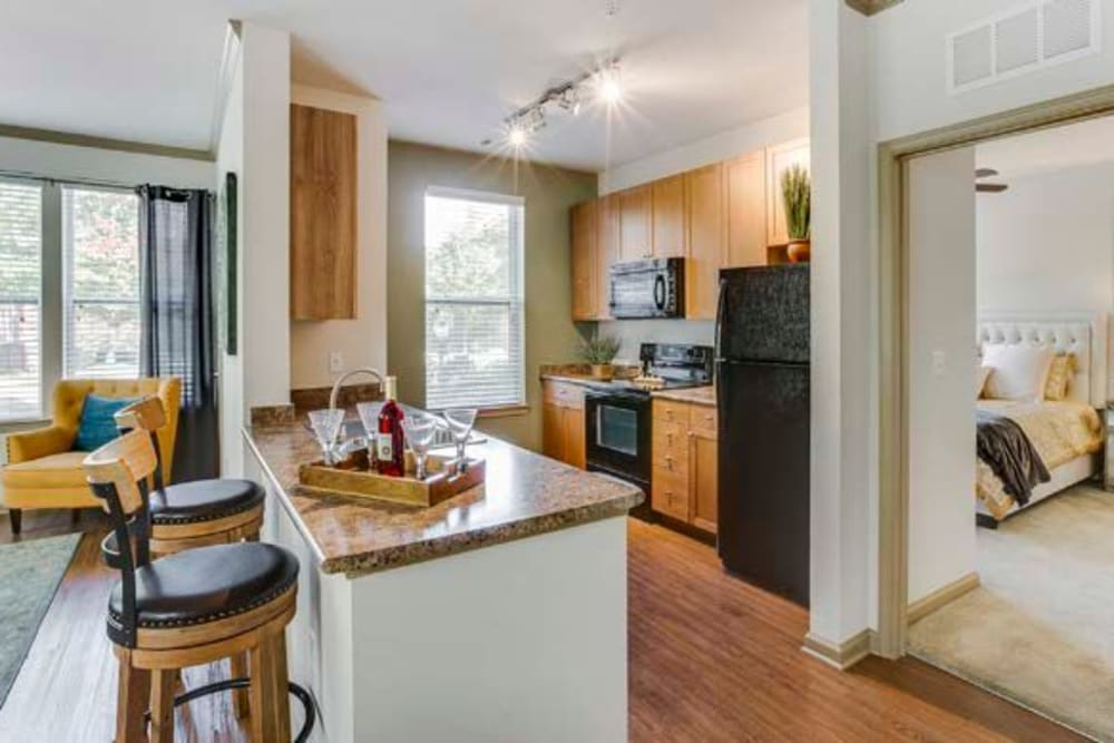 Decorated kitchen with breakfast bar and tons of counter space at Summerfield at Morgan Metro in Landover, Maryland
