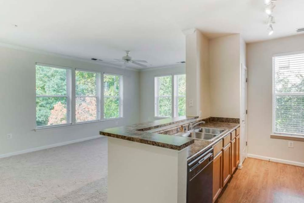 Empty kitchen with breakfast bar and lots of windows for tons of natural light at Summerfield at Morgan Metro in Landover, Maryland