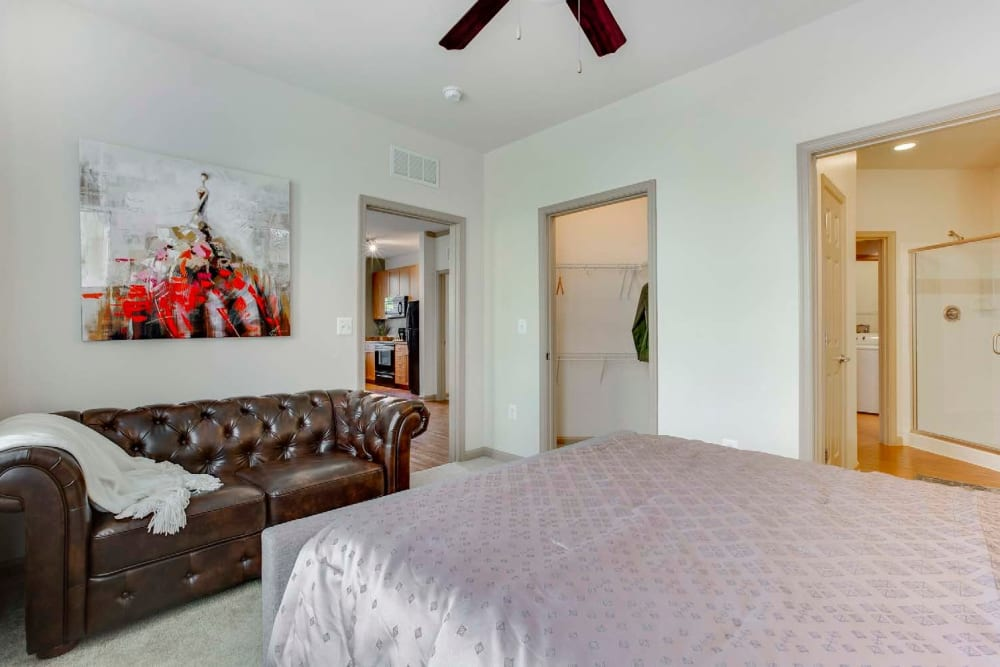 Model bedroom with ceiling fan and lots of closet space at Summerfield at Morgan Metro in Landover, Maryland