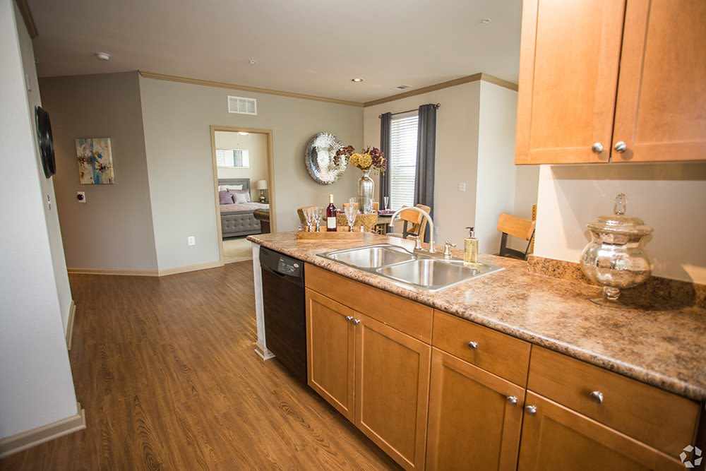 Model kitchen with breakfast bar and tons of counter space at Summerfield at Morgan Metro in Landover, Maryland
