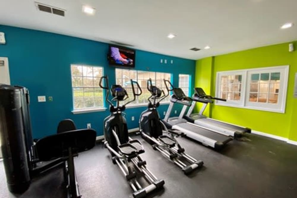 Well-equipped fitness center with terrific view of the community at 1801 MetroWest in Orlando, Florida