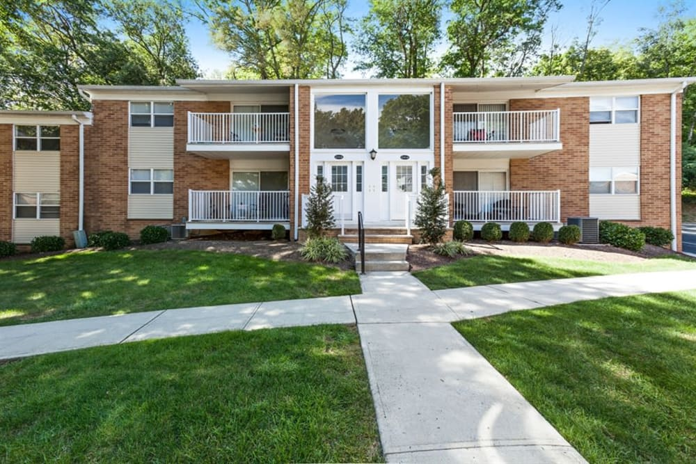 Exterior photo of the walkway and courtyard leading up to the entrance of Eagle Rock Apartments at North Plainfield in North Plainfield, New Jersey