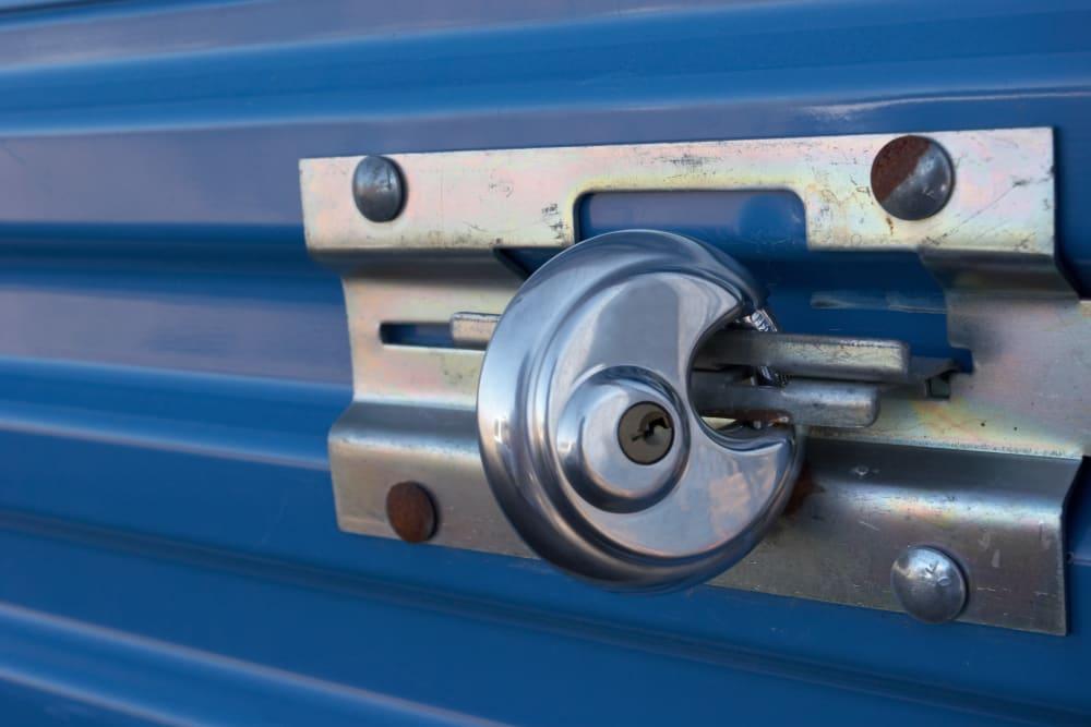 A lock on a blue storage unit door at Storage Etc... Salt Lake South in Salt Lake City, Utah