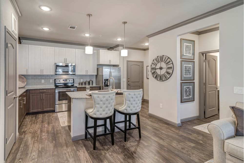 Kitchen with wood-style flooring at Caliza in Cedar Park, Texas