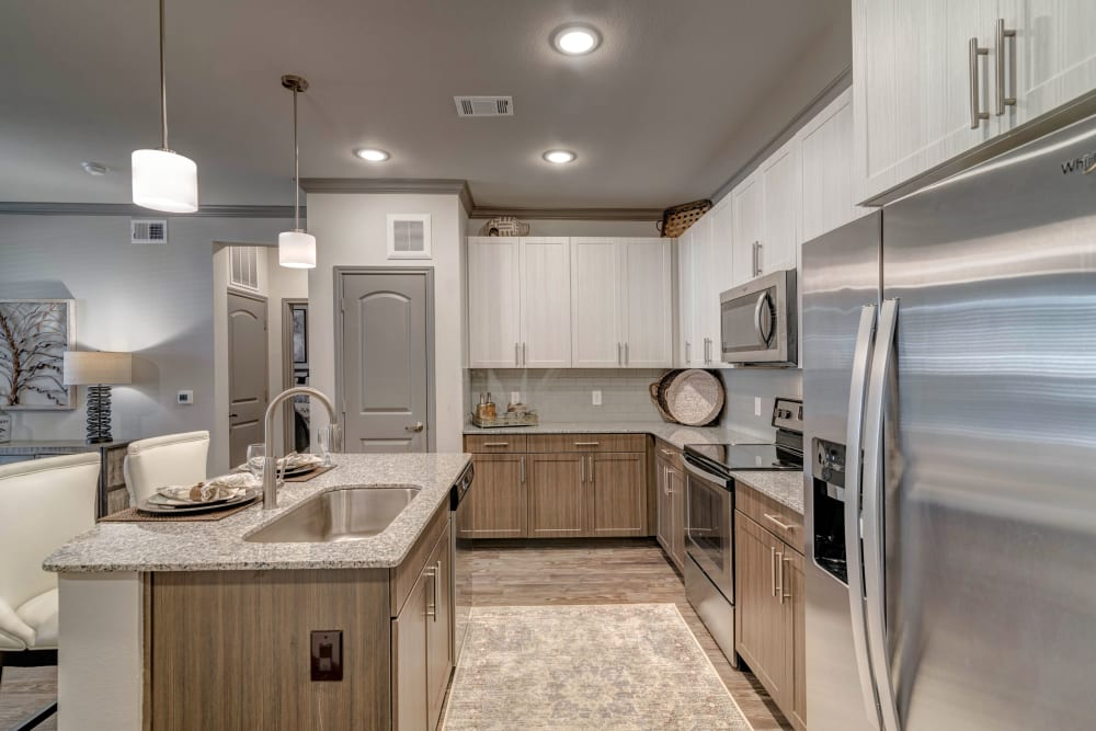 Kitchen with stainless steel appliances at Caliza in Cedar Park, Texas