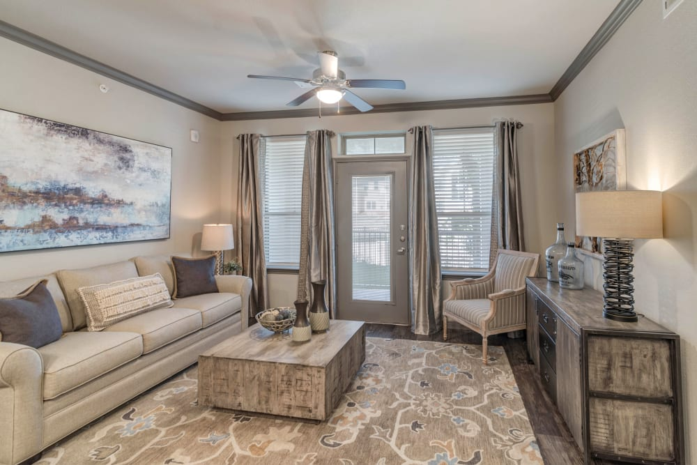 Living room with patio access at Caliza in Cedar Park, Texas
