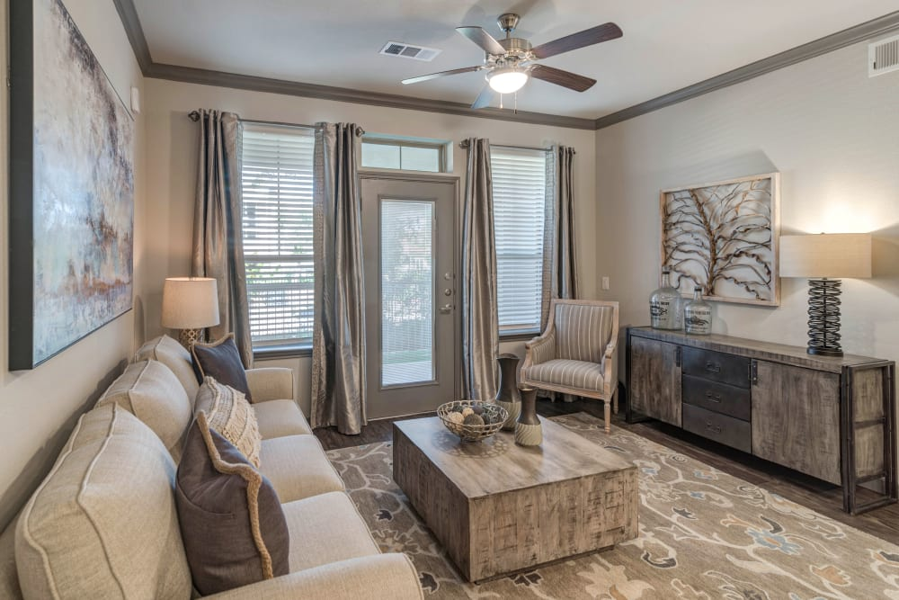 Living room with a ceiling fan at Caliza in Cedar Park, Texas