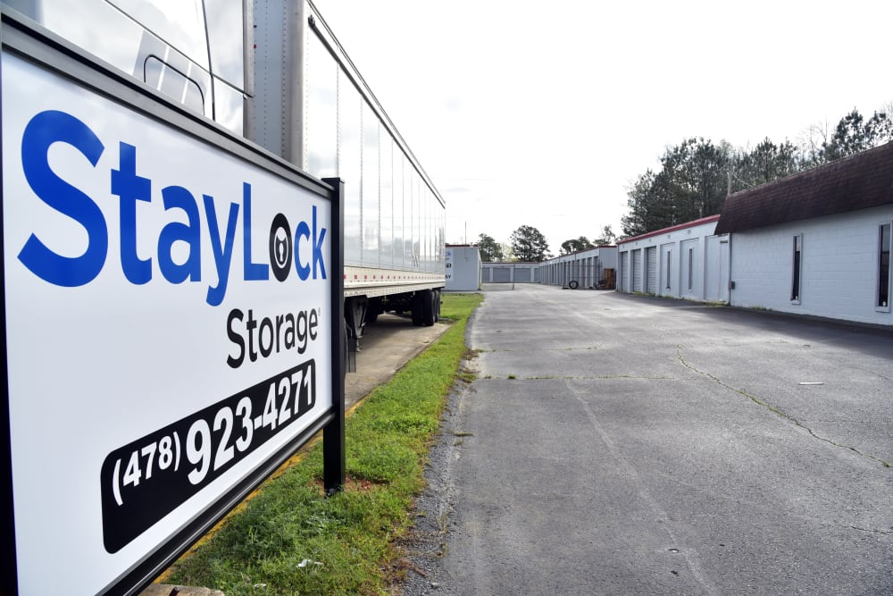 Row of storage units and sign of StayLock Storage in Warner Robins,GA