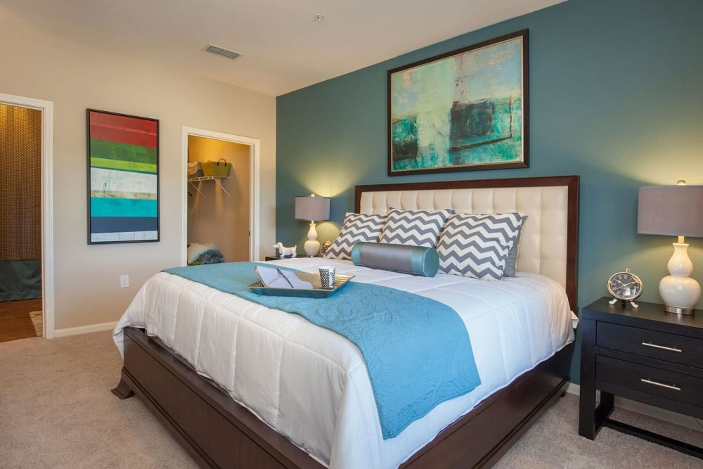 Well-lit bedroom at Integra Hills Preserve Apartments in Ooltewah, Tennessee