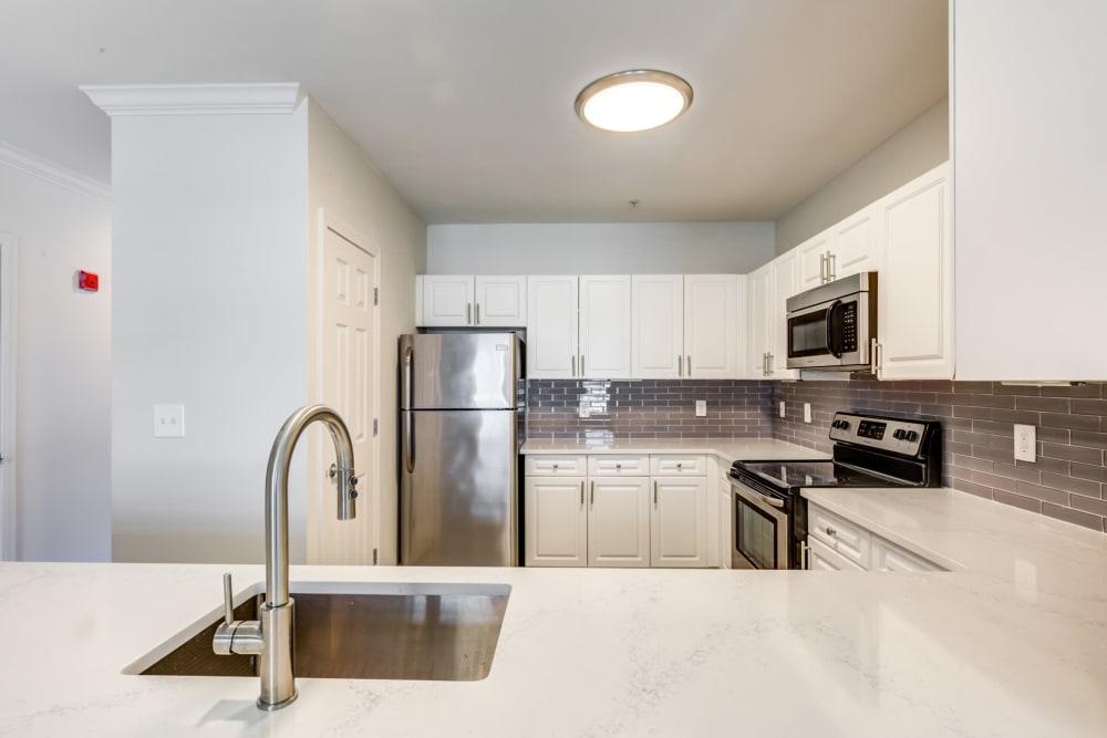 Kitchen with modern appliances at Sofi at Salem Station in Salem, MA