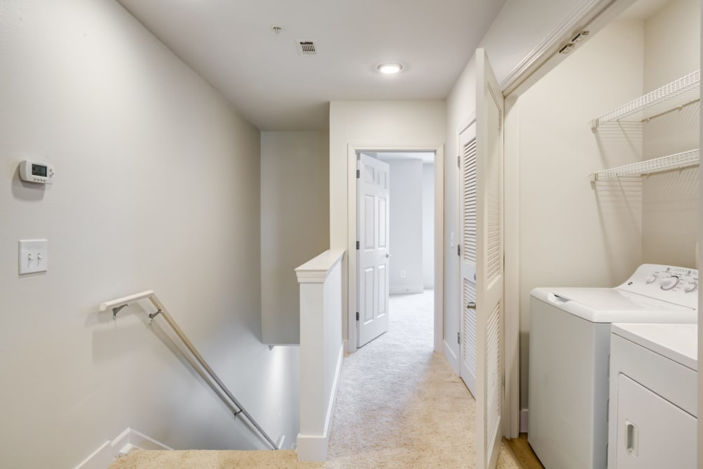 Upstairs hallway with washer and dryer in unit at Sofi at Salem Station in Salem, MA