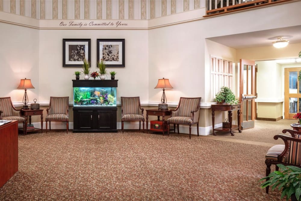 Seating area with a fish tank at Pacifica Senior Living Sterling in Sterling, Virginia