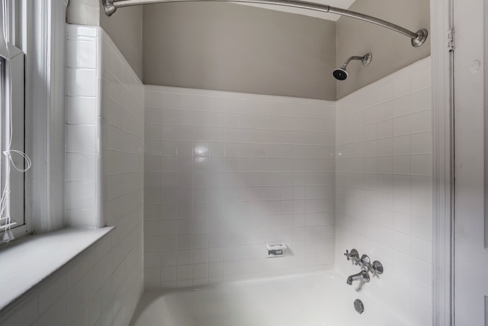 Large tiled shower at Avondale Apartments in Bethesda, Maryland