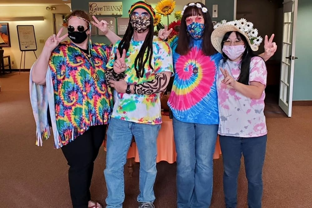 Ray Stone Inc. employees dressed in 70's costumes